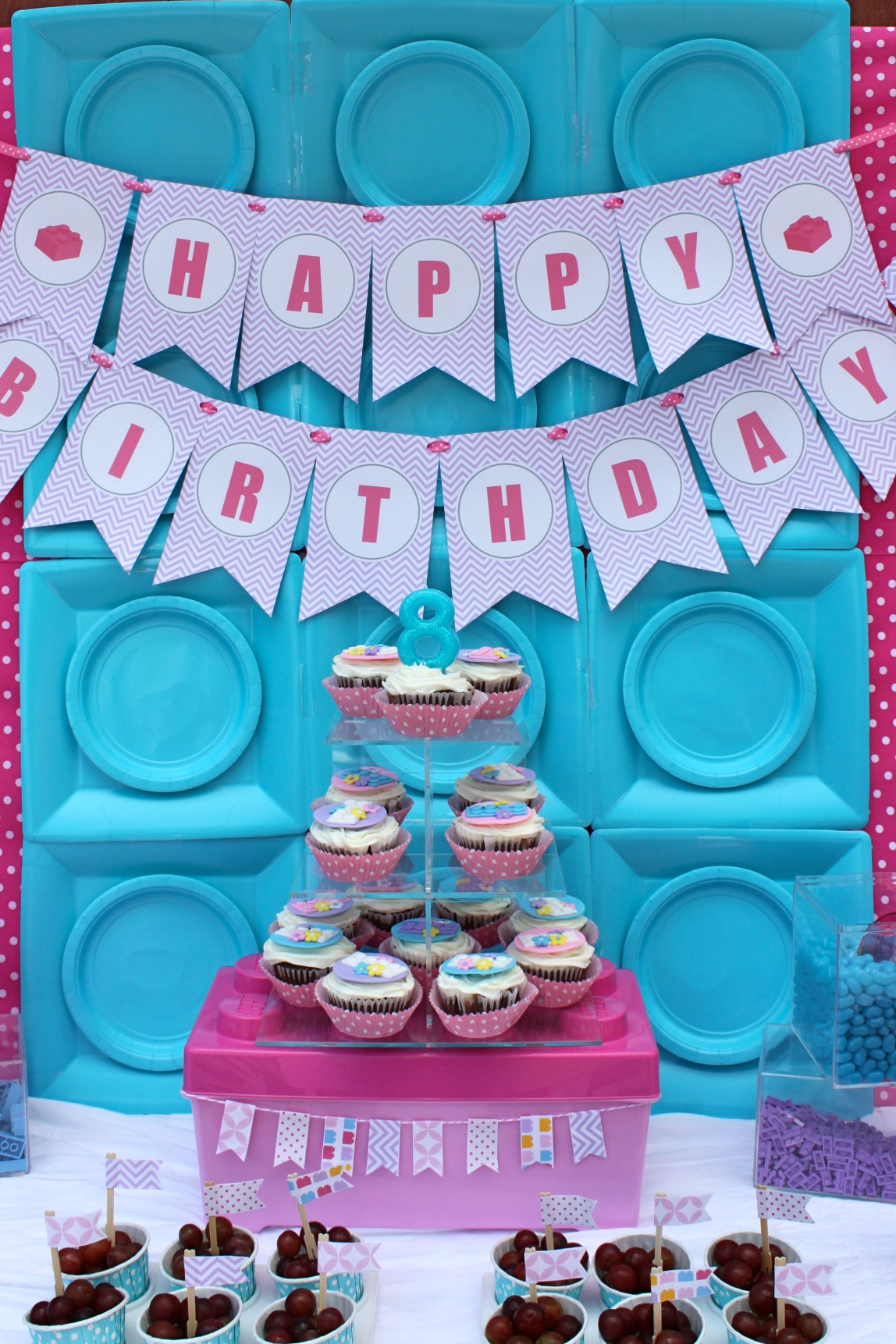 Madison wanted cupcakes so I had Lego cupcake toppers made by Carrie Budke of AngelCakes. I placed them on an acrylic cake stand set atop a giant Lego box. & Lego Friends Party | Partying with the Princesses